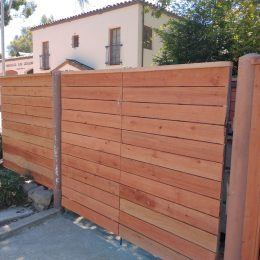Horizontal Redwoodood Fence with Top Cap and Gate